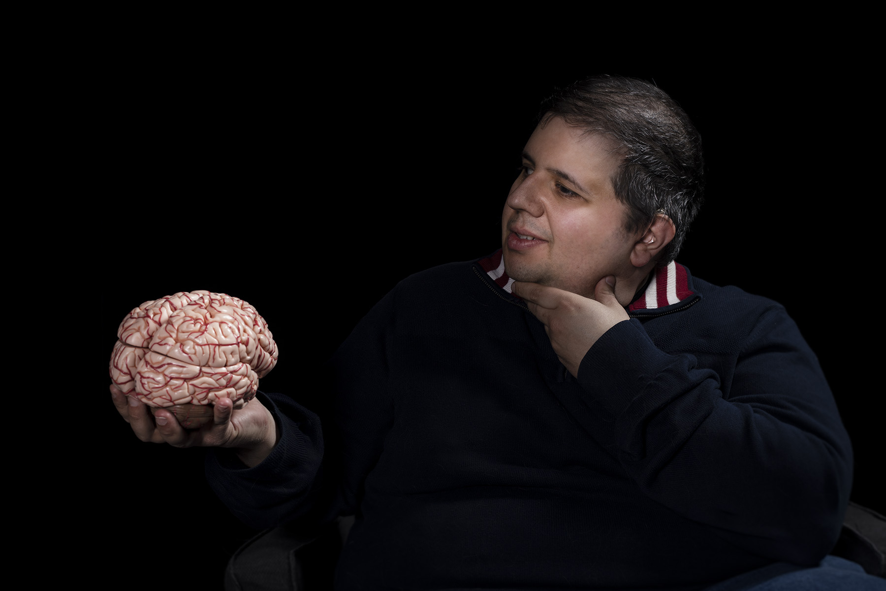 Christopher Schiafone holds a model of the human brain