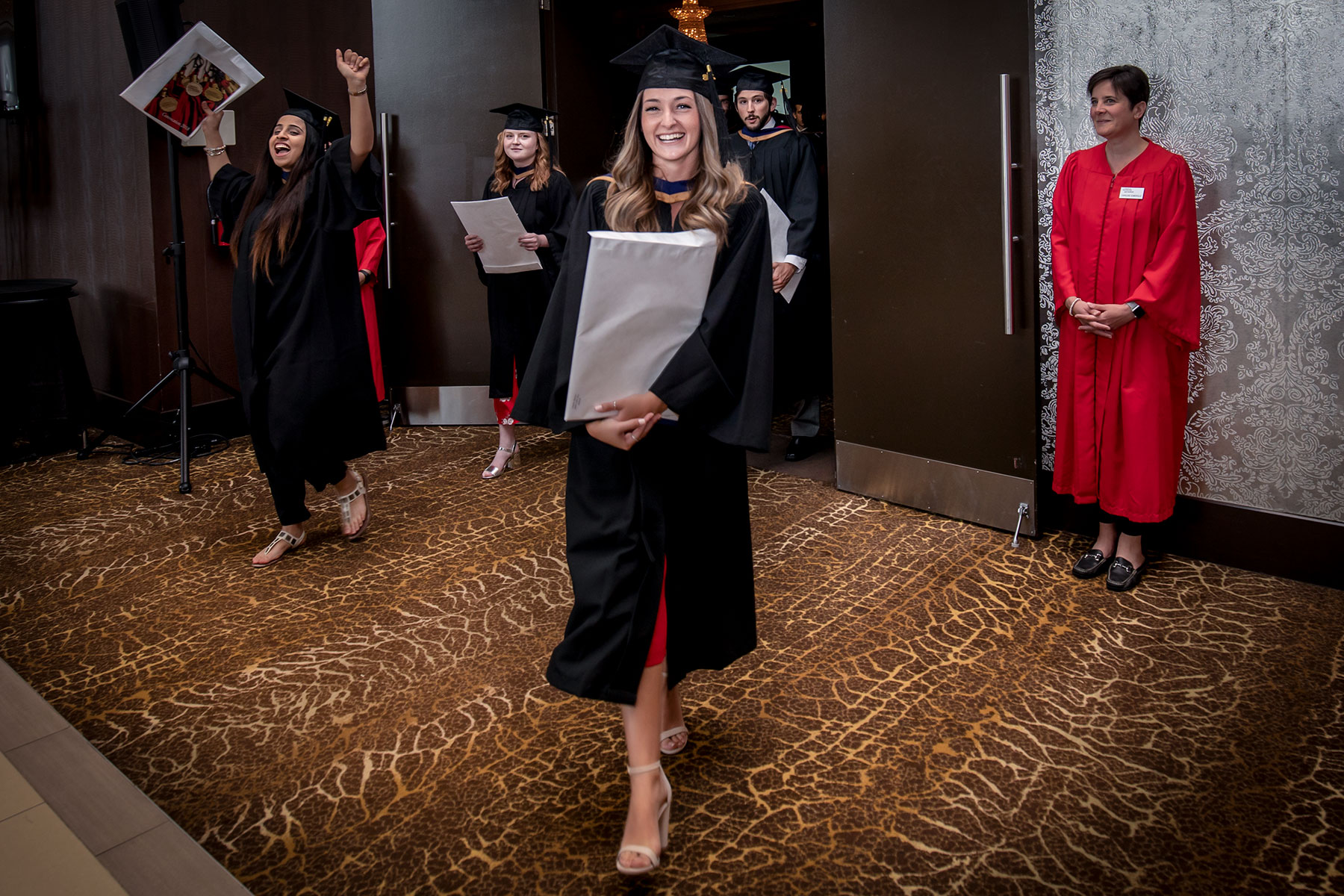 Students celebrate with their degrees and diplomas