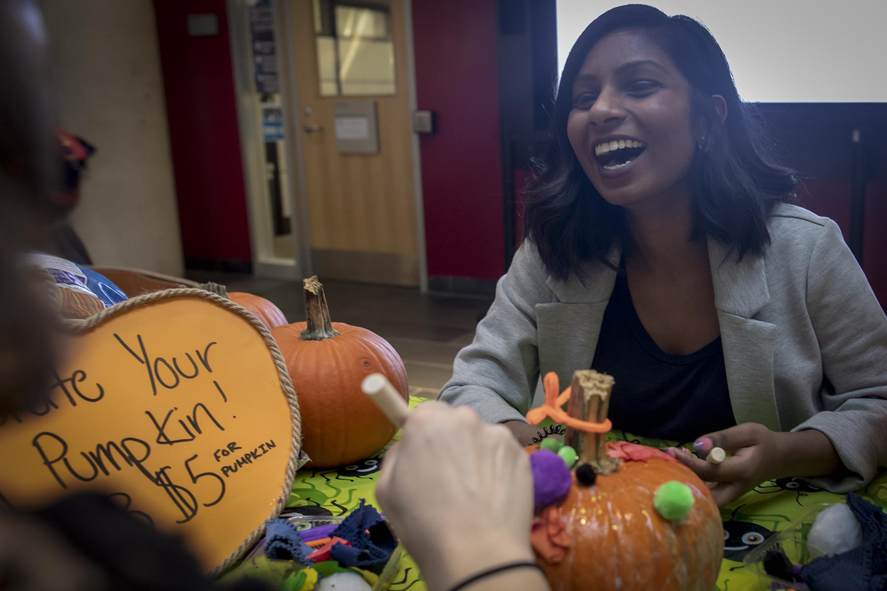 Aren Sammy decorates pumpkins