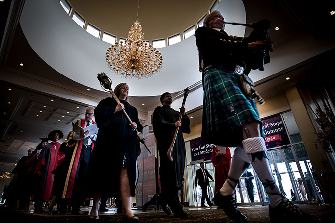 Convocation 2018 - A bagpiper leads guests into Convocation