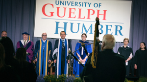 UofGH faculty gathers on stage at Convocation