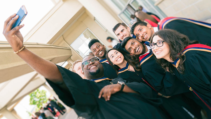 A group of grads pose for a selfie
