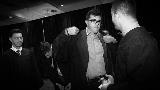 Two graduates bump fists