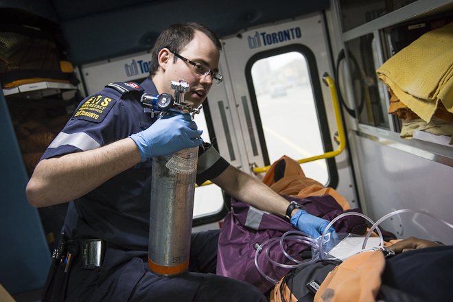 Paramedic administers oxygen