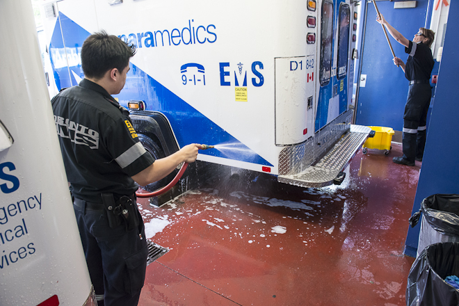 Paramedics wash ambulance