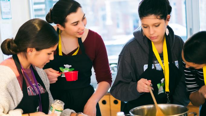 Three students cooking at Ronald McDonald House