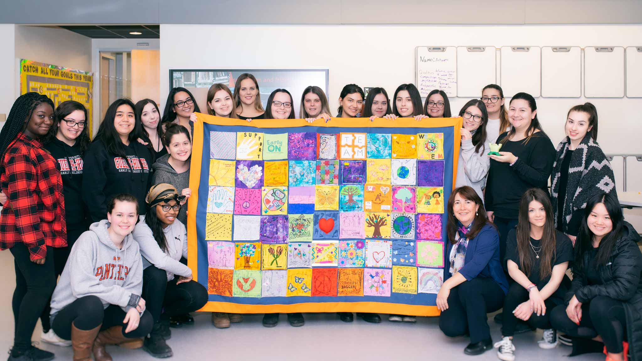 ECS students pose with their finished quilt