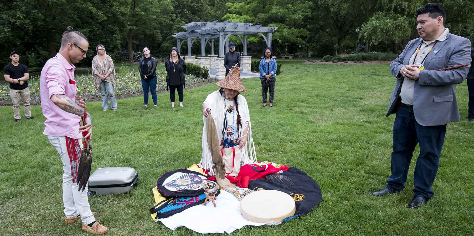 Red Medicine Woman prays during the Closing Ceremony