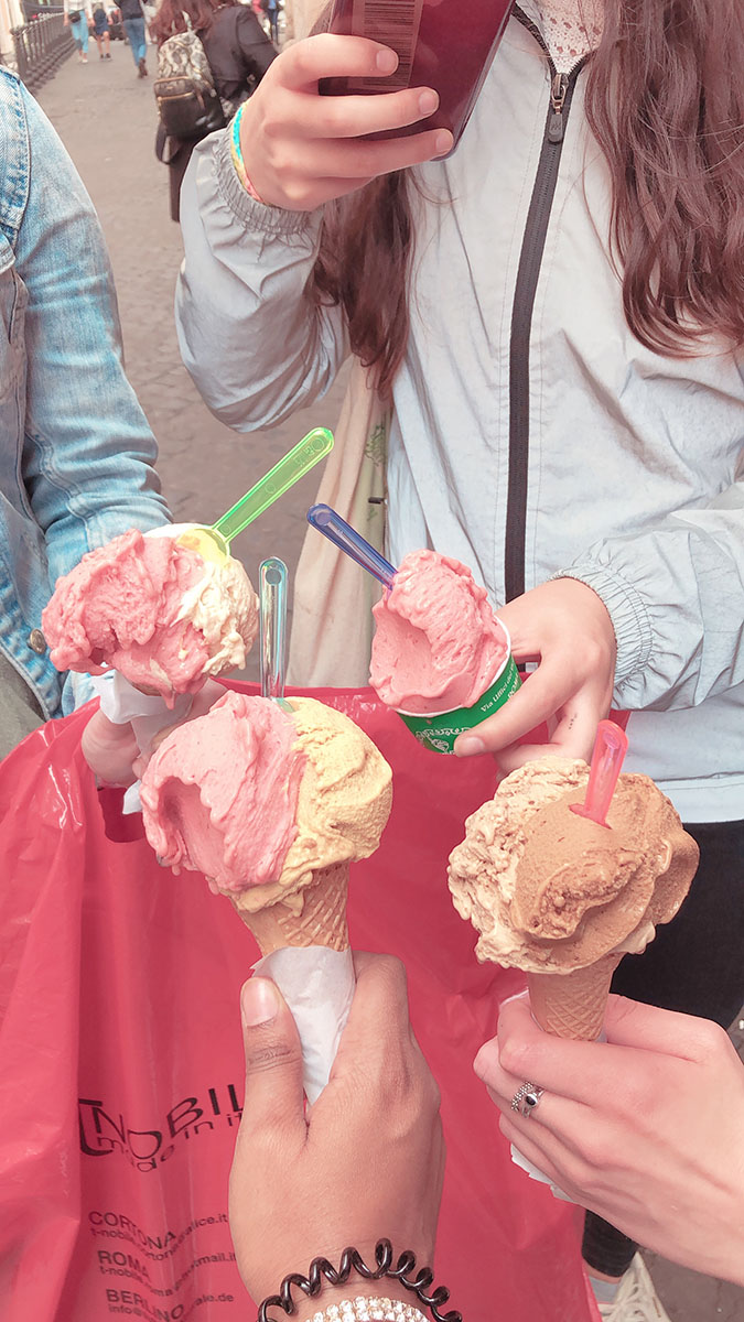 Four students hold up gelato