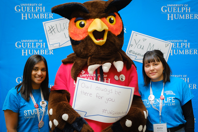 Two student volunteers pose with Swoop