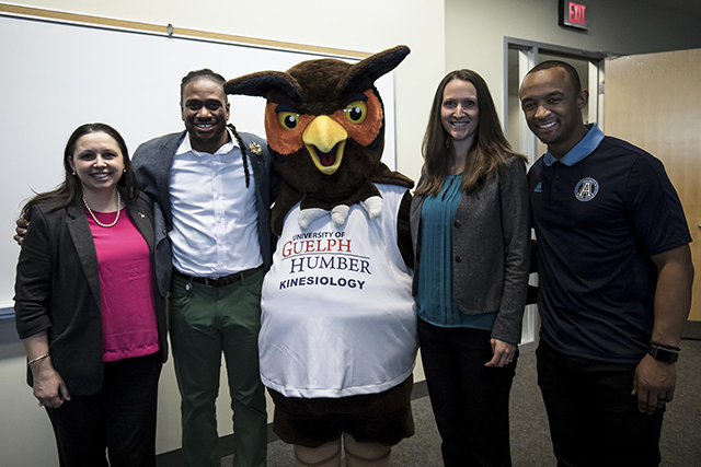 Matt Black poses with Swoop and UofGH faculty