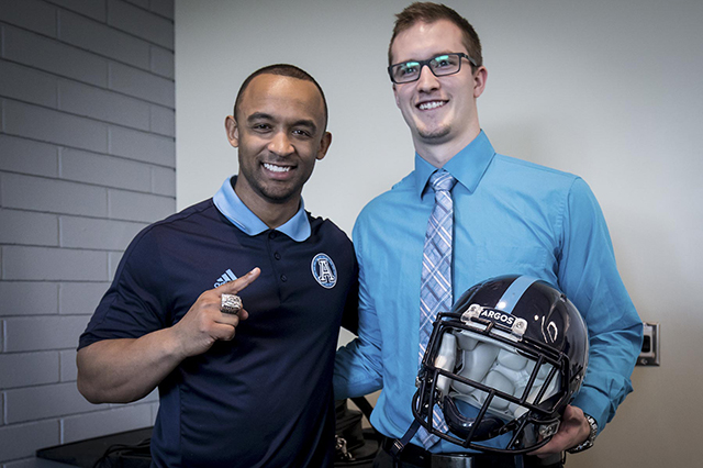 Matt Black with a student and an Argos helmet