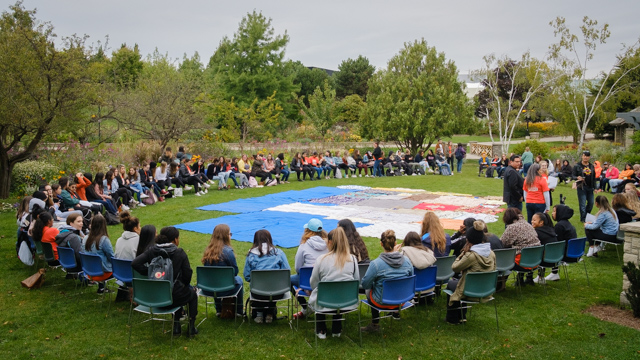 Students sitting in a circle at the Blanket Exercise