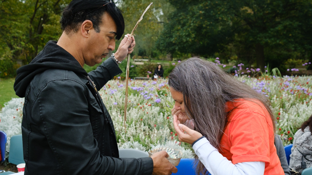 Dr. Nikki Martyn participates in smudging exercise
