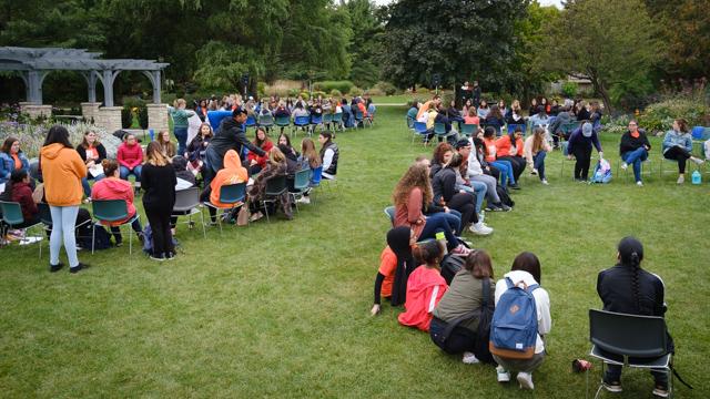 Students sit in talking circles