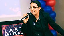 A female speaker at the podium.