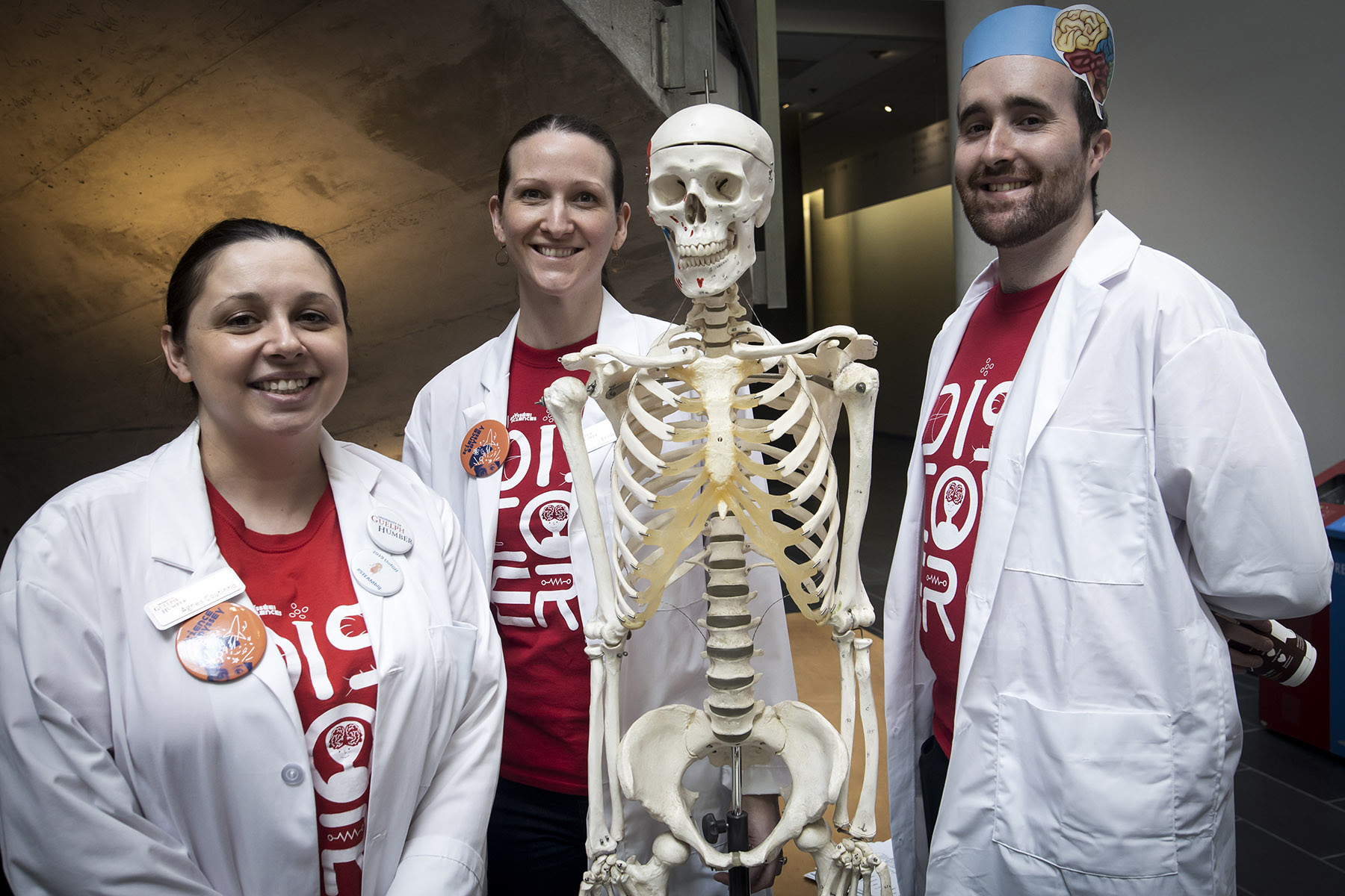 exhibitor posing picture with skeleton