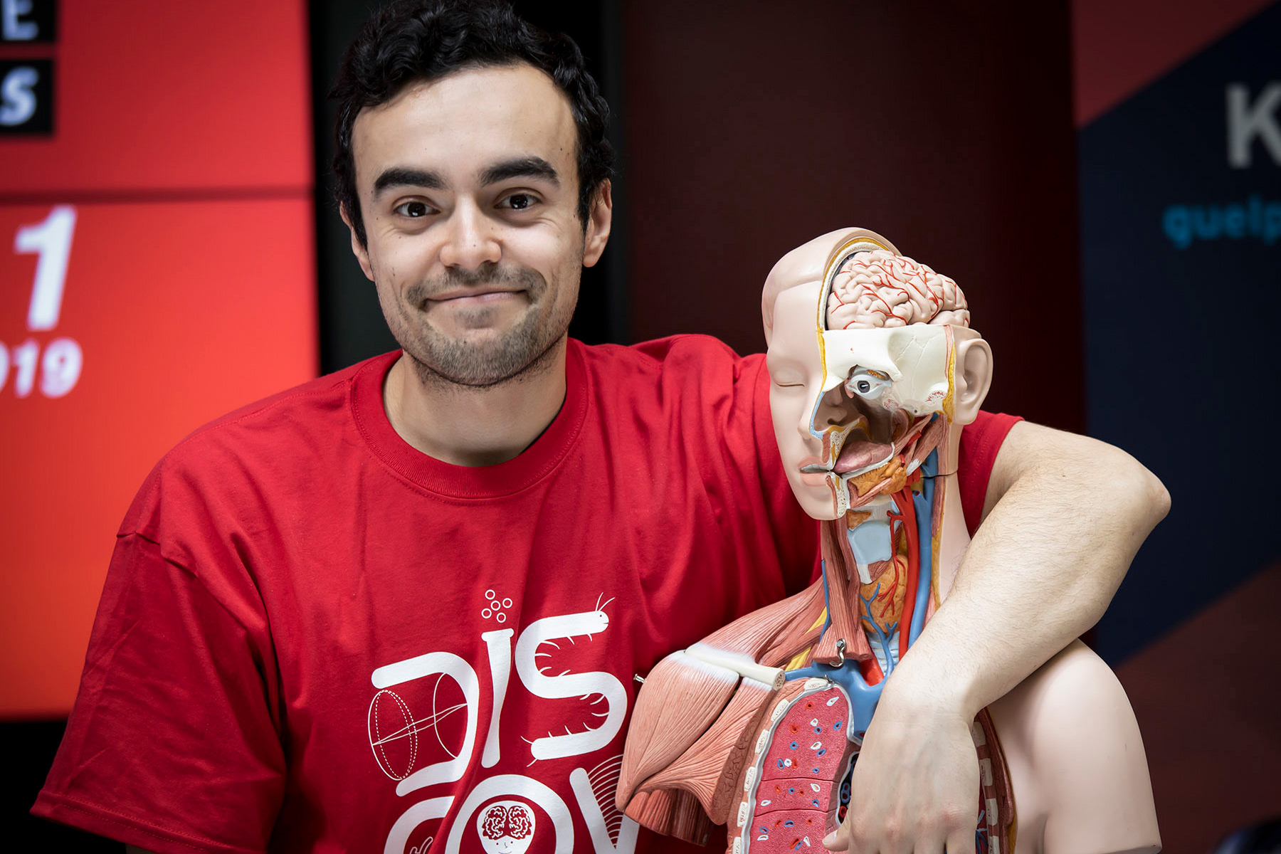 exhibitor posing for picture with dummy human