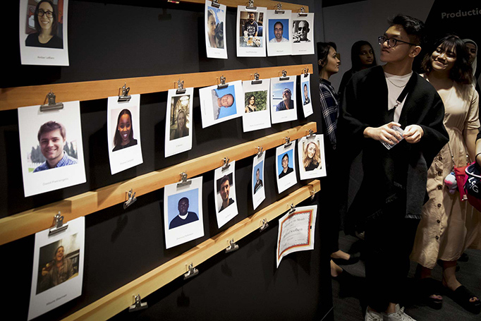 Students look at the on-air talent's headshots