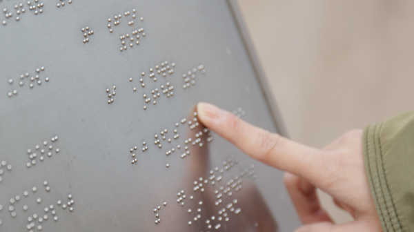 a finger on braille