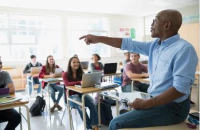 Teacher talks to his class