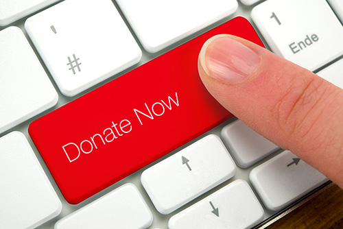 keyboard with red button that says donate now